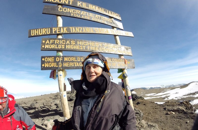 anne lorimor at the summit of mt. kilimanjaro