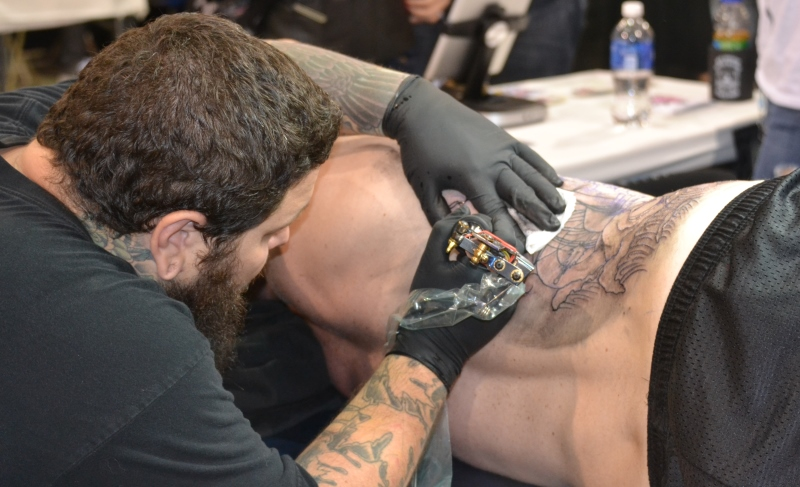 man getting a tattoo