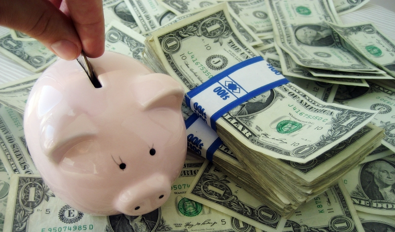 putting money in a piggy bank_New_Love_Times