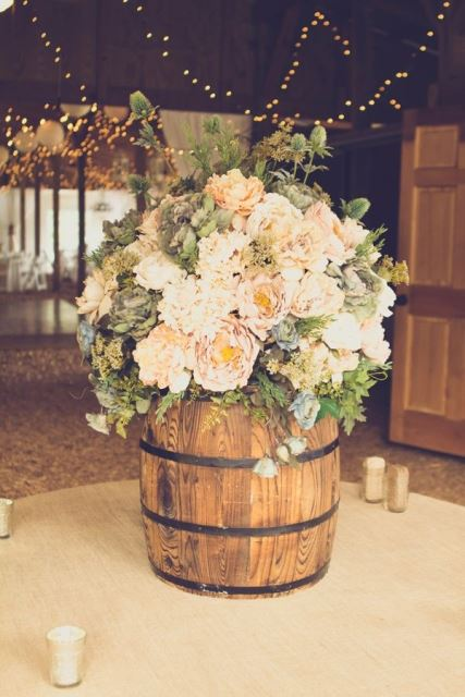 rustic flowers in whiskey barrels