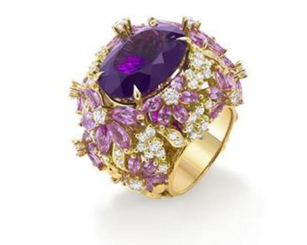 Pink sapphires. amethyst and diamond ring