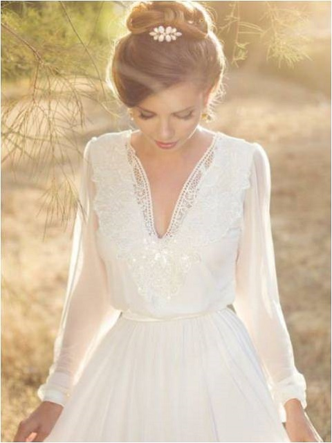 Puffed sleeves on Bohemian style wedding gown