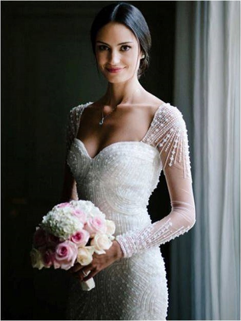 Cap sleeved fitted wedding gown
