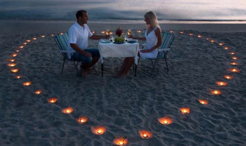 couple having dinner on a beach_New_Love_Times