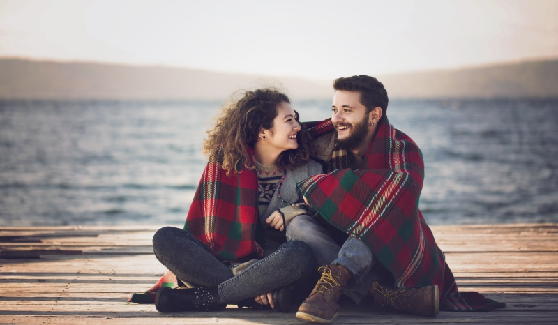 couple huddled under a blanket together