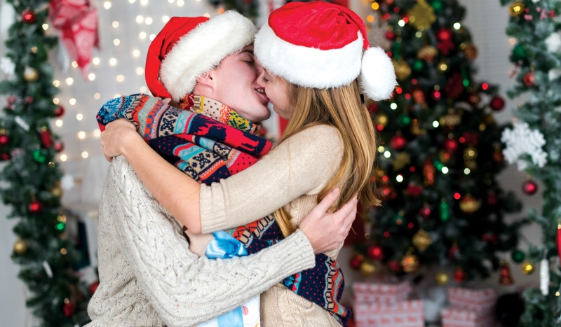 couple kissing on christmas