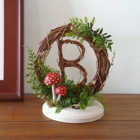 rustic letter with grapevine topper