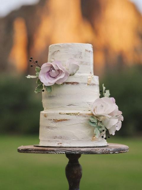 Grazed white three-tiered chocolate cake