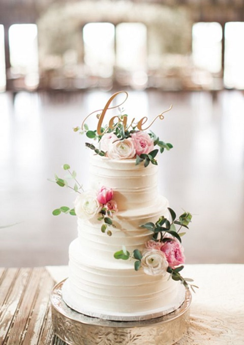 Simplistic cake with unique cake topper