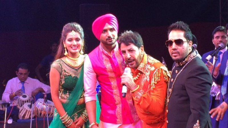 geeta basra and harbhajan singh with gurdas mann and mika singh at their sangeet ceremony