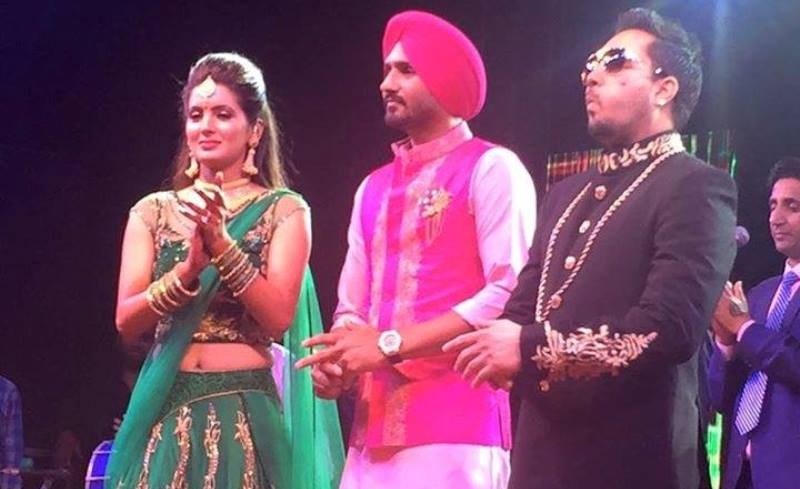 geeta basra and harbhajan singh with mika singh at their sangeet ceremony