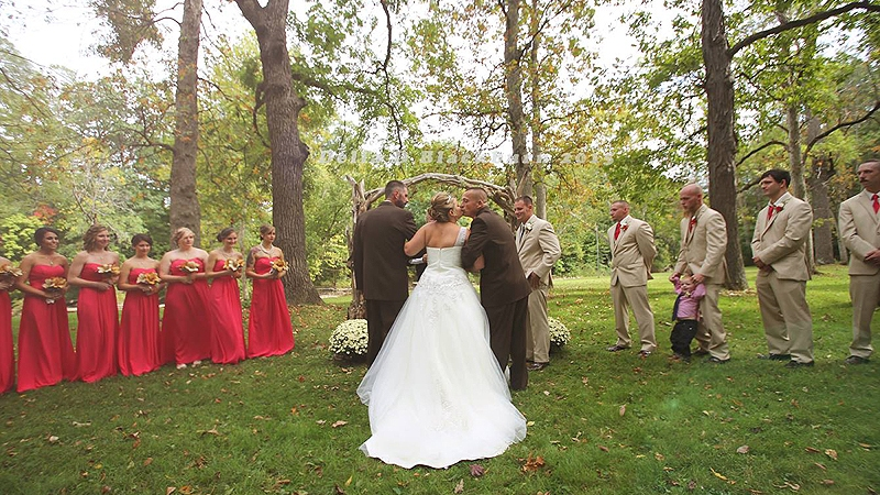 Todd Bachman and Todd Cendrosky walking their daughter down the aisle