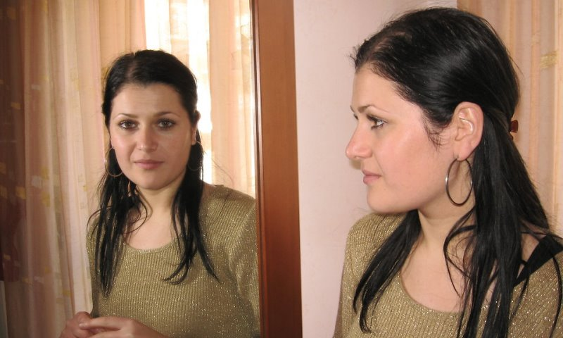 woman looking in mirror_New_Love_Times