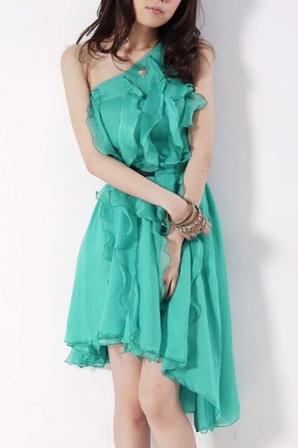woman in a green dress_New_Love_Times