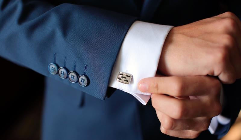 man adjusting his cuff_New_Love_Times