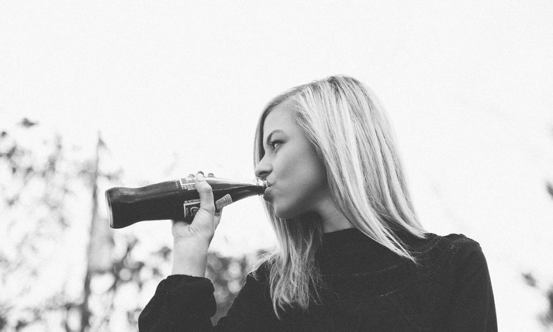 woman drinking cola_New_Love_Times