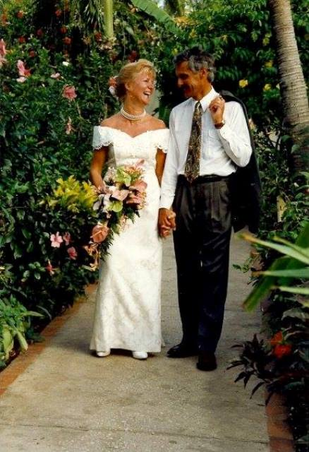 yvonne trimble with her husband in her wedding gown_New_Love_Times