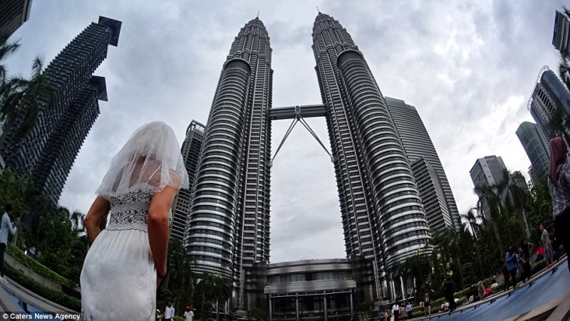 pavlina in front of the petronas towers, kuala lumpur, malaysia_New_Love_Times