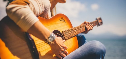 woman playing a guitar_New_Love_Times