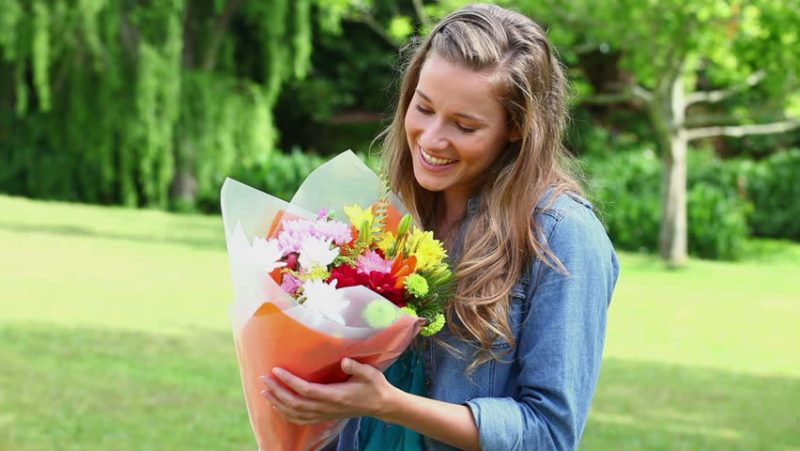 woman holding flowers_New_Love_Times