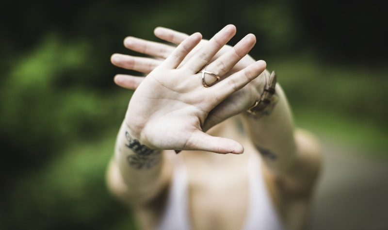 woman holding up her hands_New_Love_Times